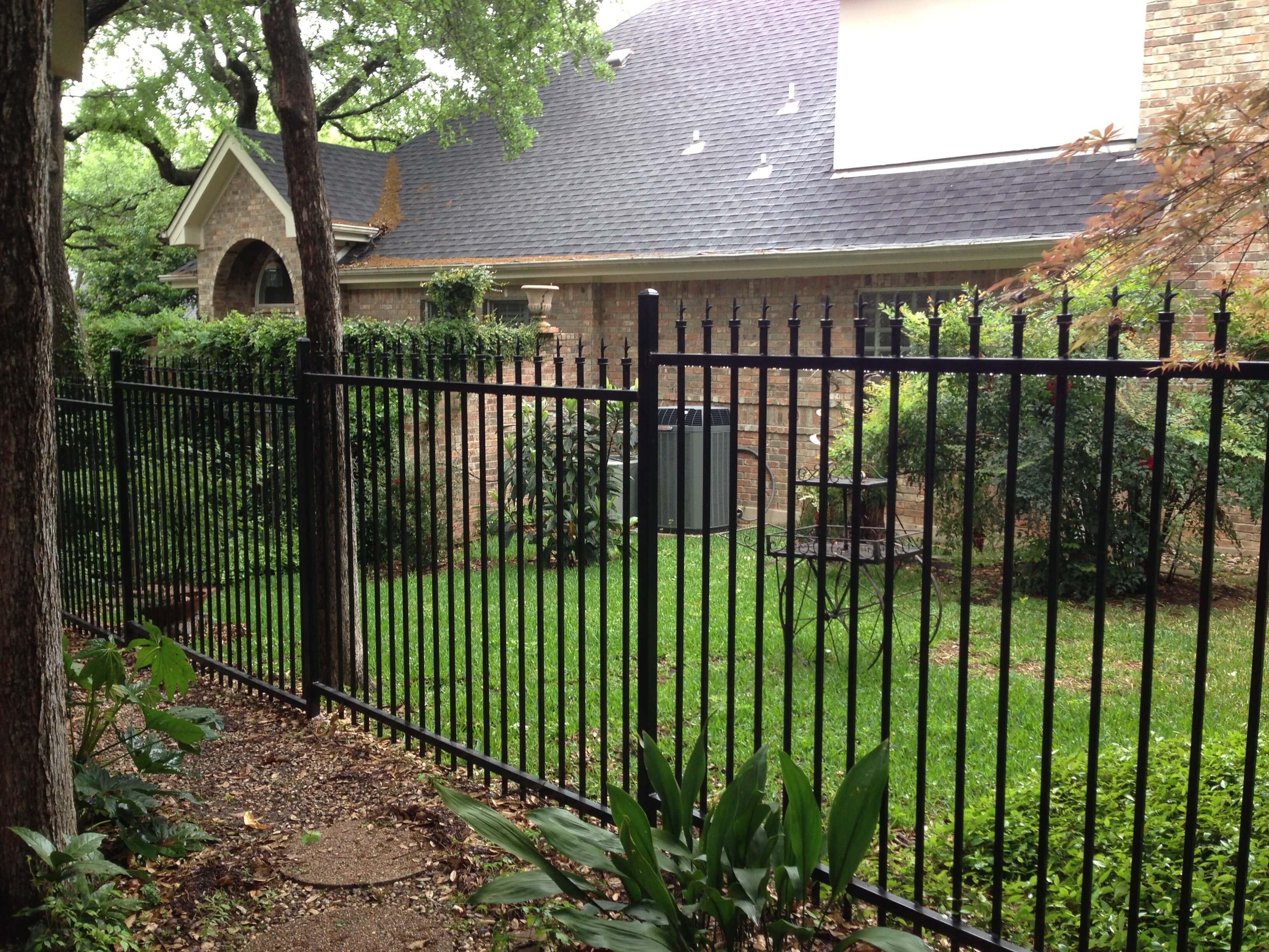 Pressed Spear Wrought Iron Fences - Apple Fence Austin, TX